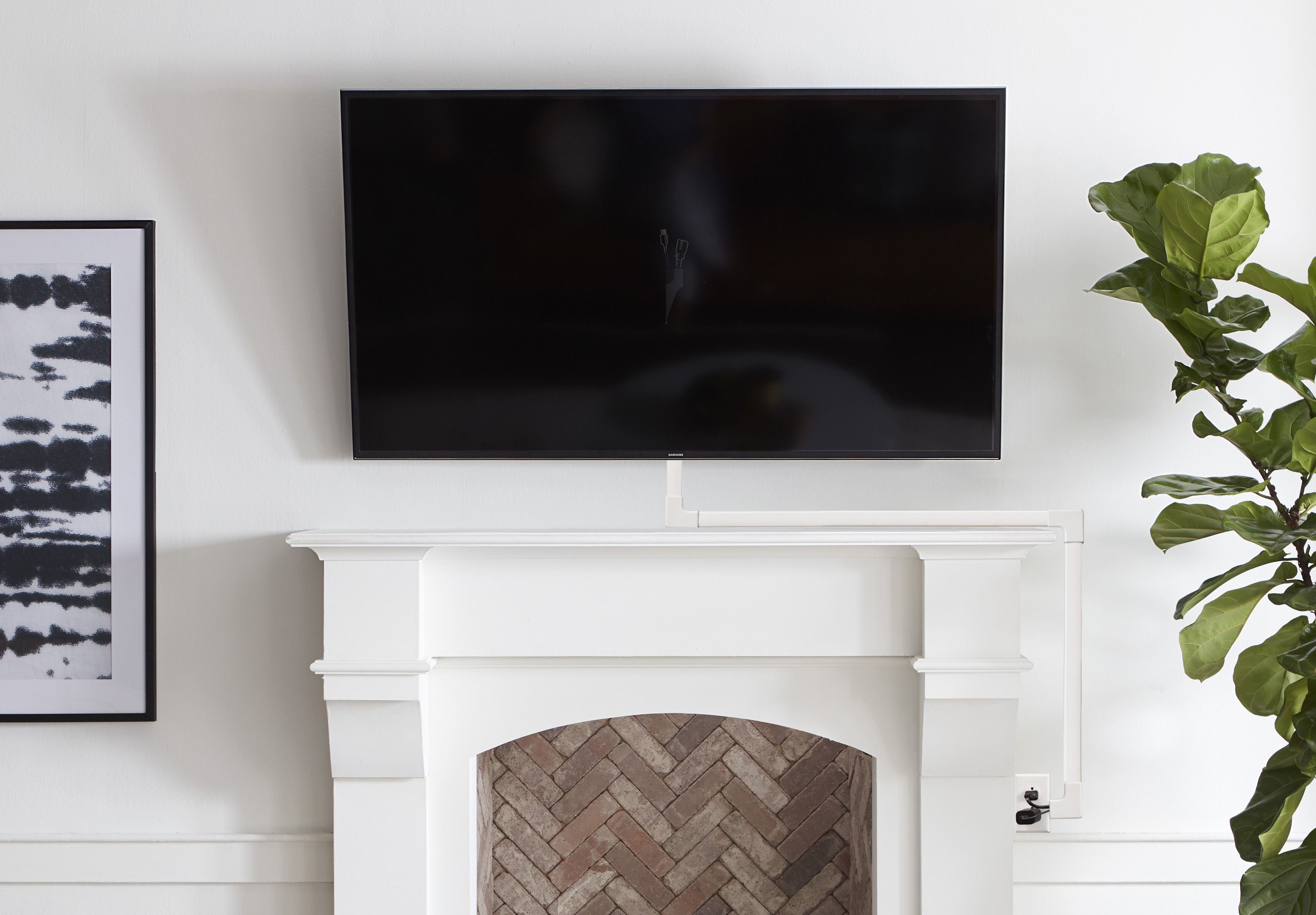 conceal tv cables over fireplace